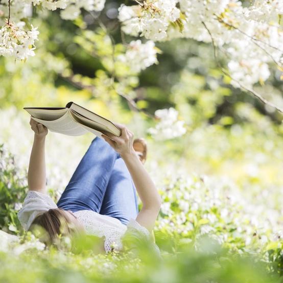 woman outside reading