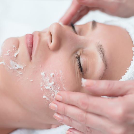woman receiving exfoliation facial