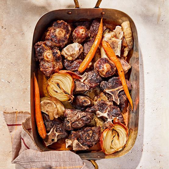 homemade beef stock ingredients in roasting pan