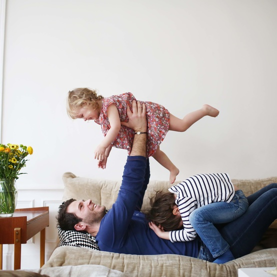 family playing on couch