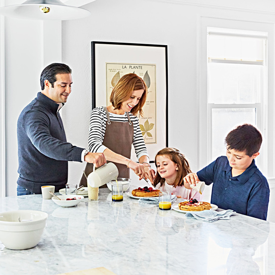 family making eating breakfast