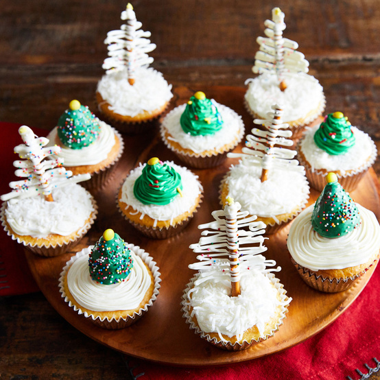 vanilla cupcakes with frosted christmas tree toppers