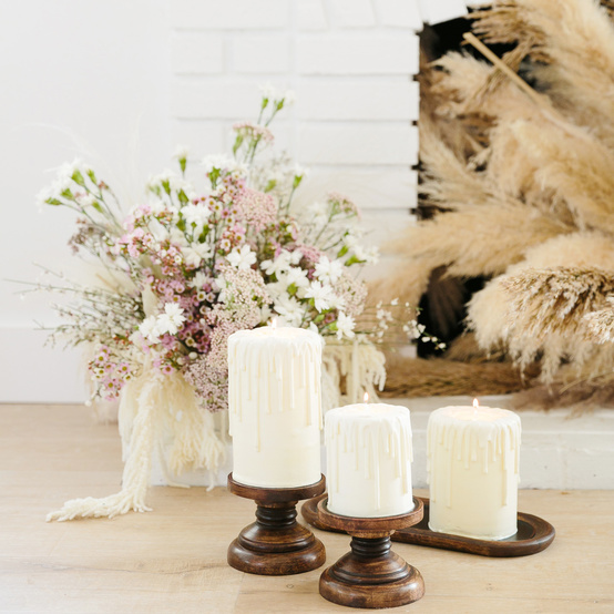 romeo and juliet valentines day party decorations candles and a white and blush bouquet near fireplace