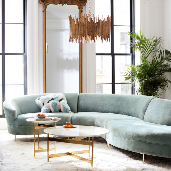 curved green sofa with palm