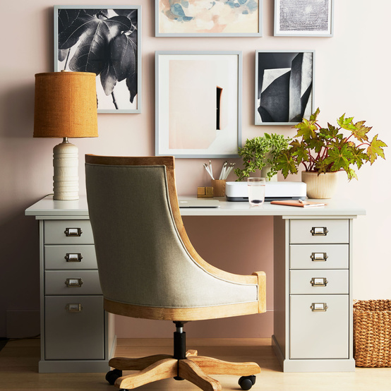 gray office desk with lamp and chair on wheels