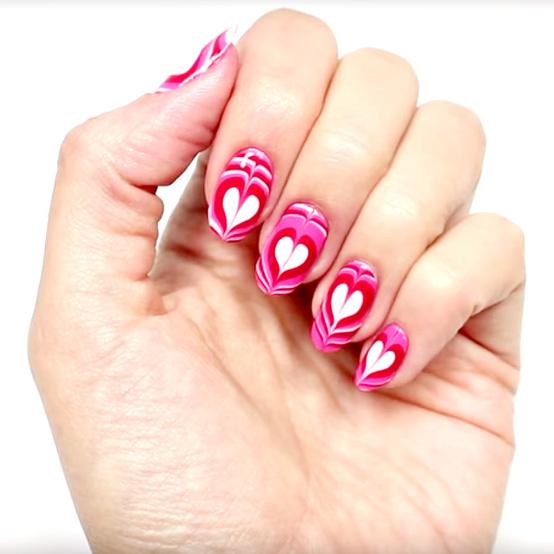 Valentine's Day marbleized heart manicure