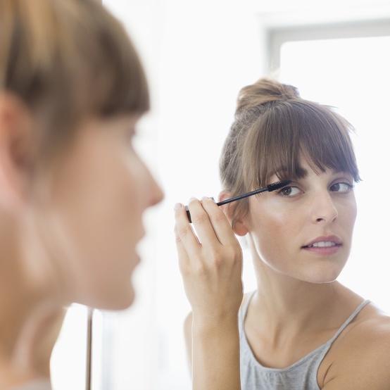 woman applying makeup mascara sensitive skin