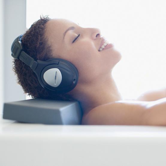 woman headphones self care bath