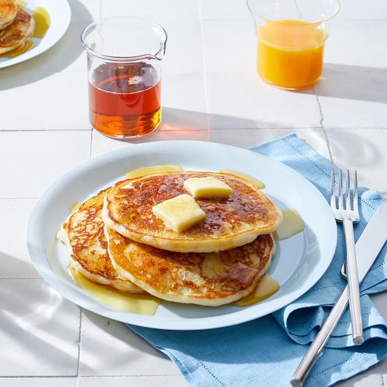 gluten free buttermilk pancakes on white plate at breakfast