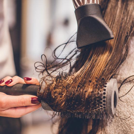 drying hair with round brush