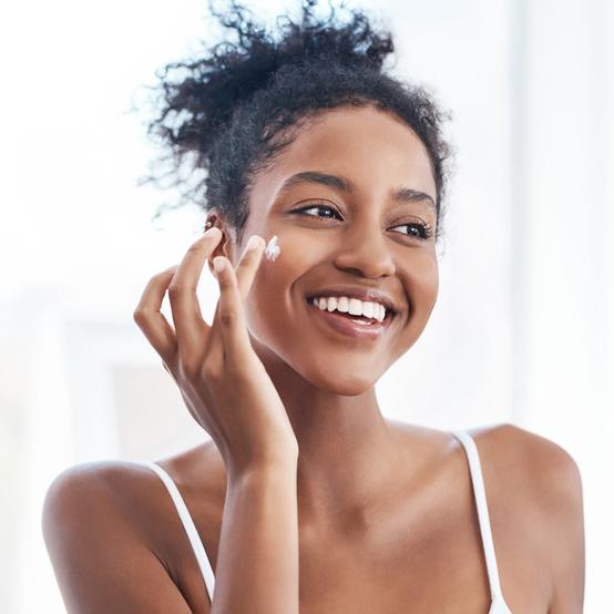woman applying morning skin care routine