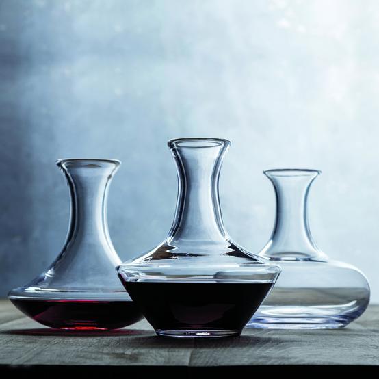 3 wine carafes on table