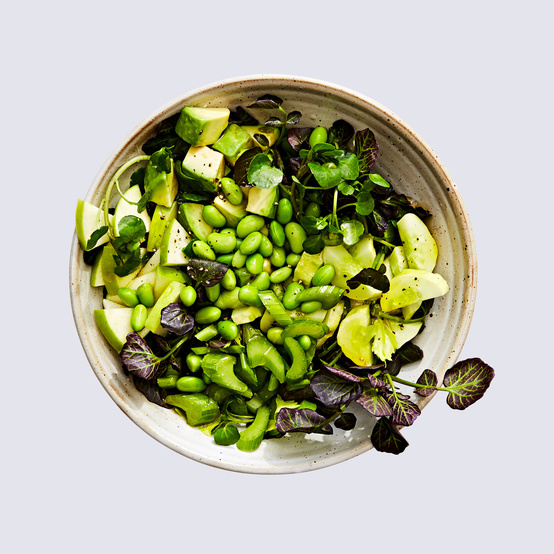 watercress chopped salad topped with edamame