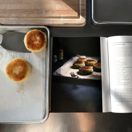 potato cakes and open cookbook