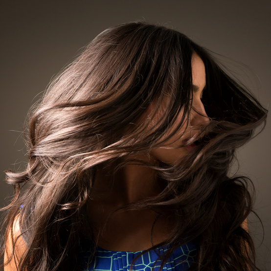 woman tossing shiny hair