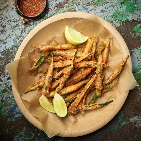 spiced fried okra served with lime wedges