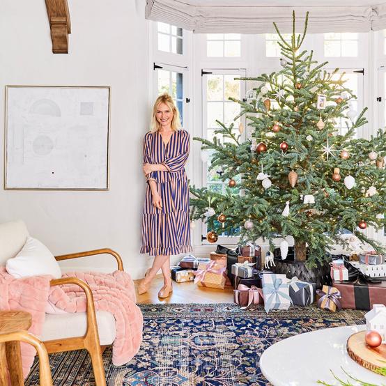 emily henderson next to christmas tree