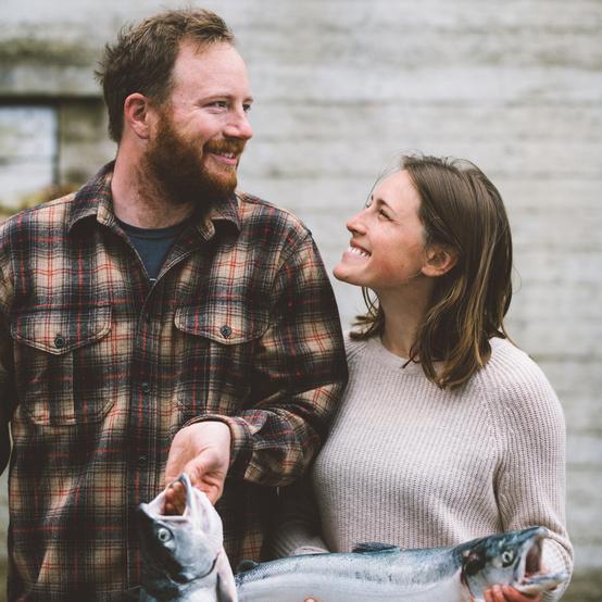couple holding salmon drifters fish