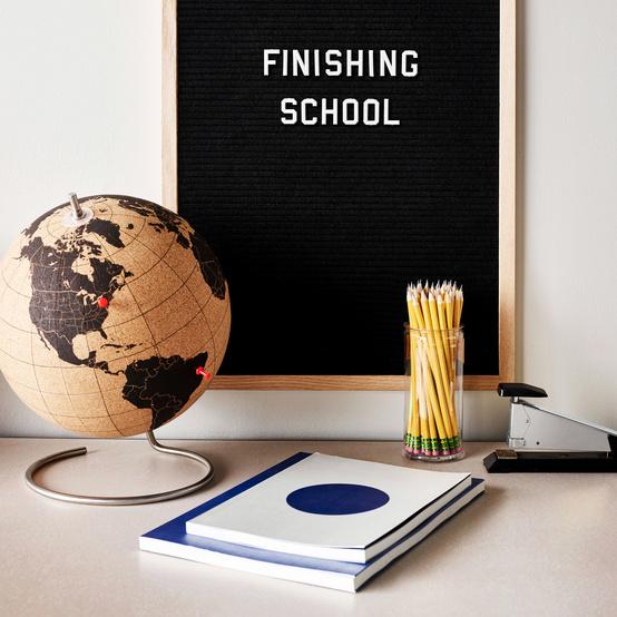 globe notebooks pencils letter board