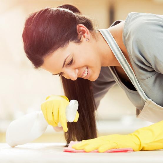 woman cleaning bleach