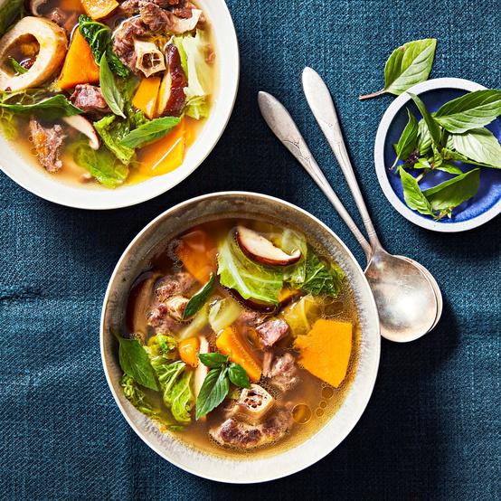 beef pumpkin and shiitake soup served with fresh basil