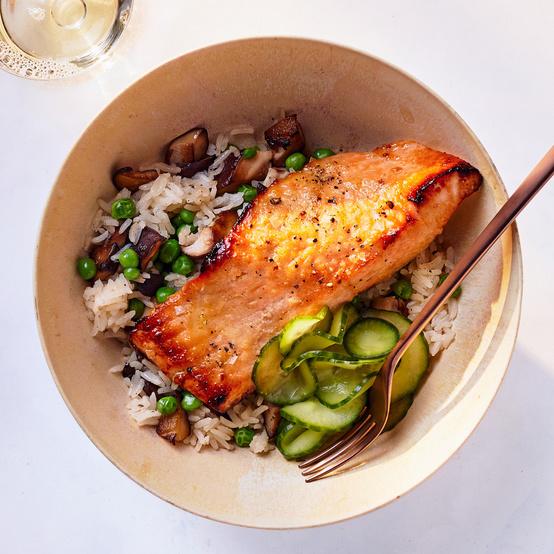 salmon-shiitake rice bowls served with cucumber
