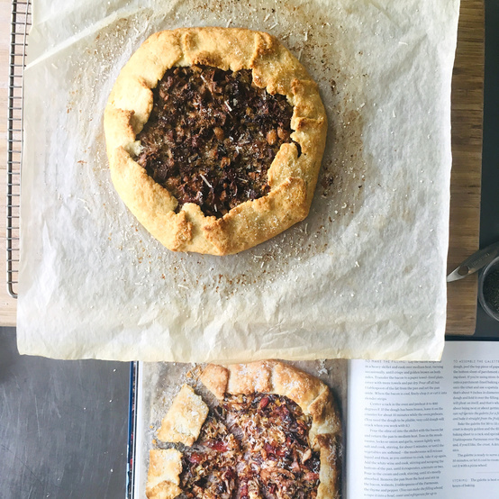 dorie greenspan mushroom galette on parchment paper with cookbook