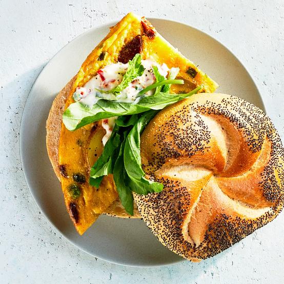 potato chorizo and egg sandwiches served with arugula
