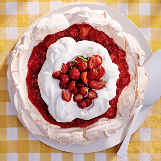 strawberry-lemonade angel pie topped with fresh strawberries