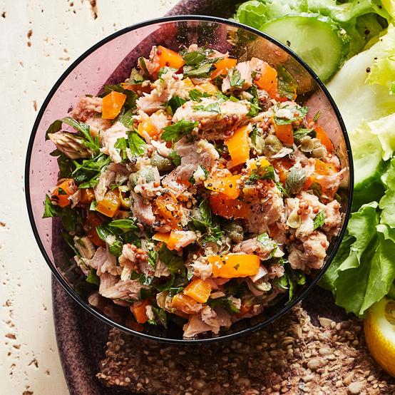 no-mayo mediterranean tuna salad served with salad greens