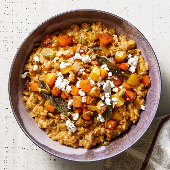 baked farro risotto with golden vegetables and goat cheese