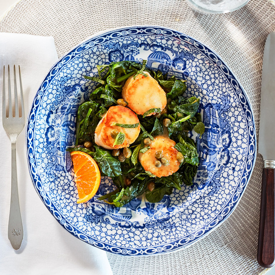 sauteed scallops with caper brown butter served with warm wilted spinach