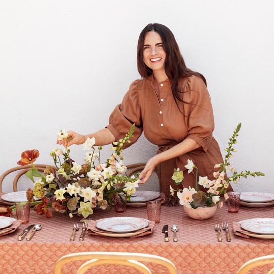 flower designer kristen caissie at table brunch