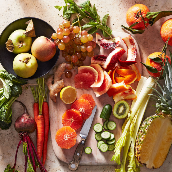 cutting board with citrus ginger cucumber beet oranges