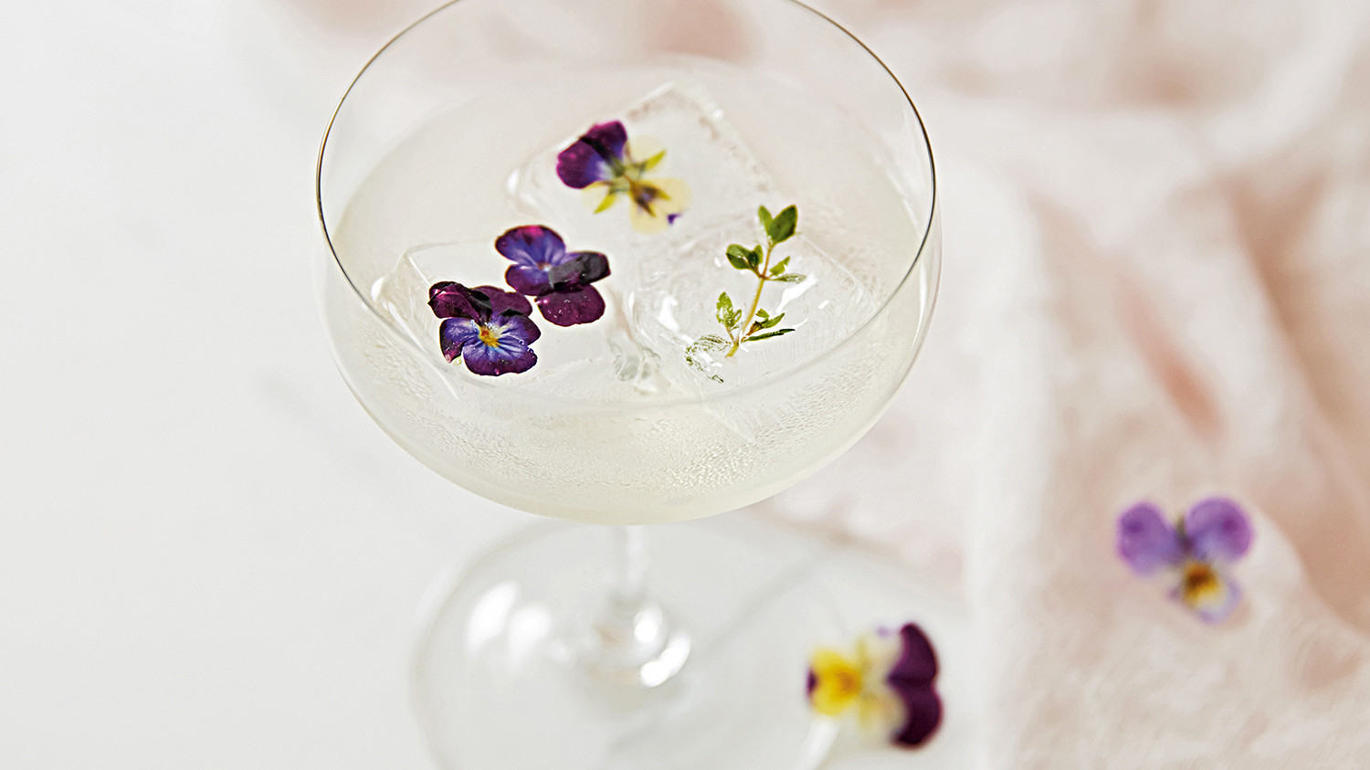 iced beverage with edible flowers