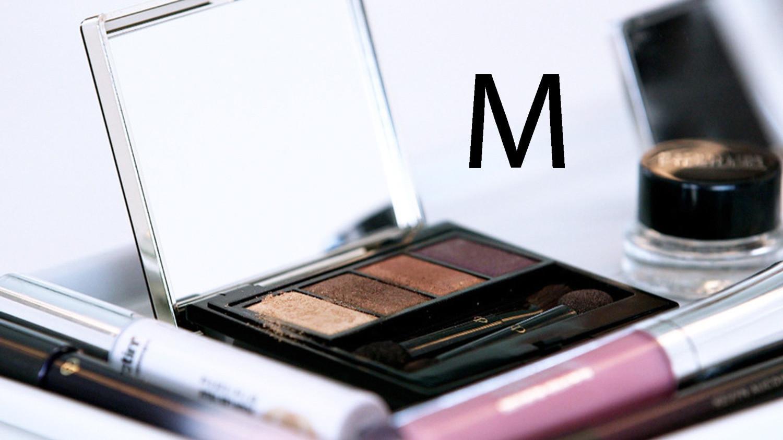 makeup compact letter m