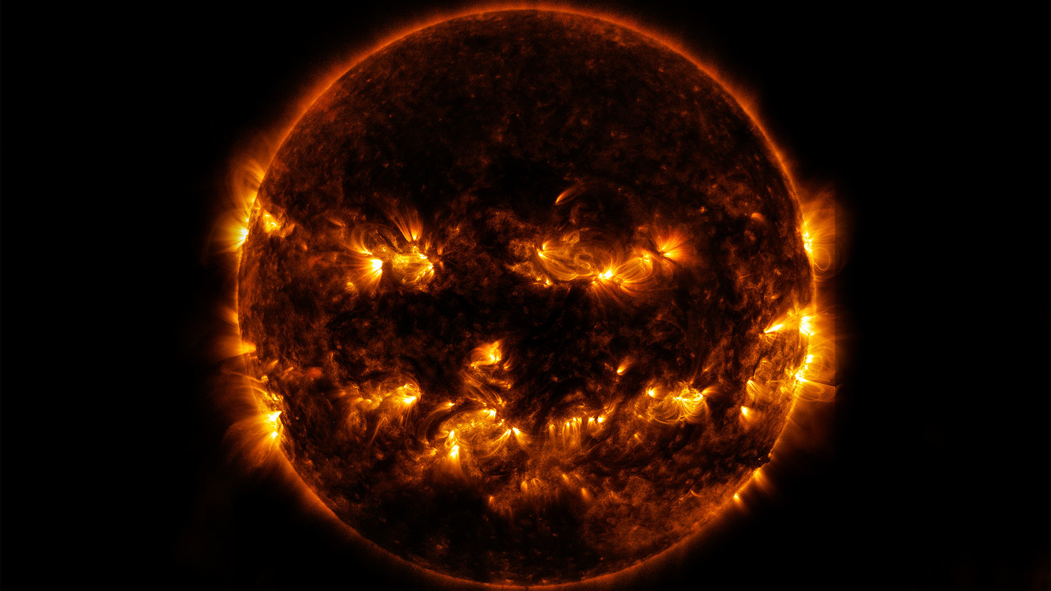 NASA Celebrates Halloween with a Spooky Photo of the Sun, Which Looks Just Like a Giant Jack-o'-Lantern