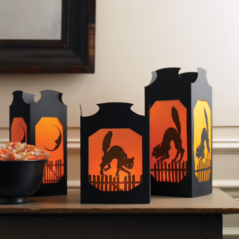 Vellum halloween table lanterns martha stewart for How to make homemade halloween decorations for inside