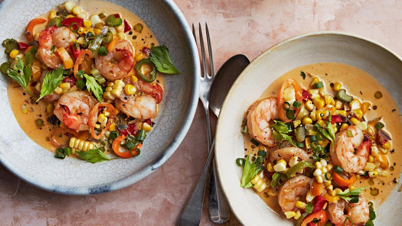 two bowls of shrimp maque choux