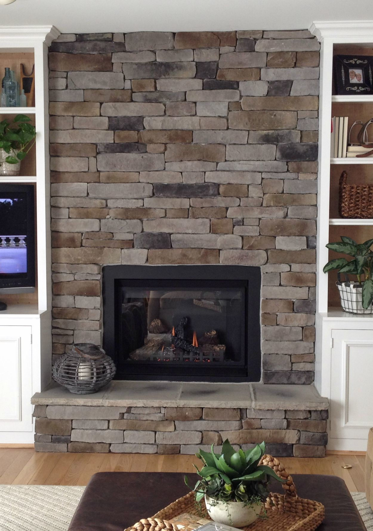 How to create the stacked stone fireplace look on a budget martha stewart - Images of stone fireplaces ...