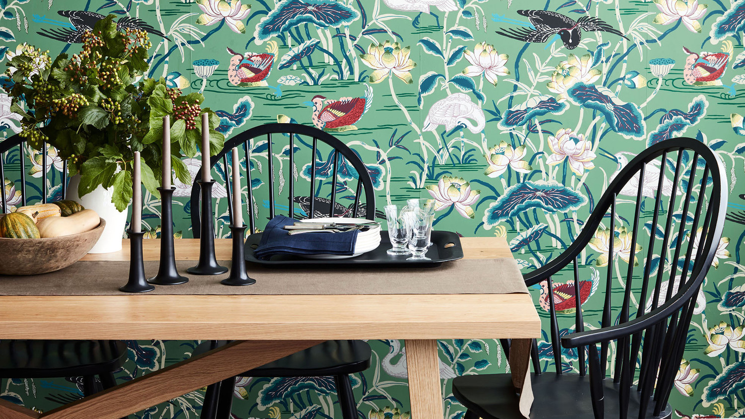dining room table chair with green birds wallpaper