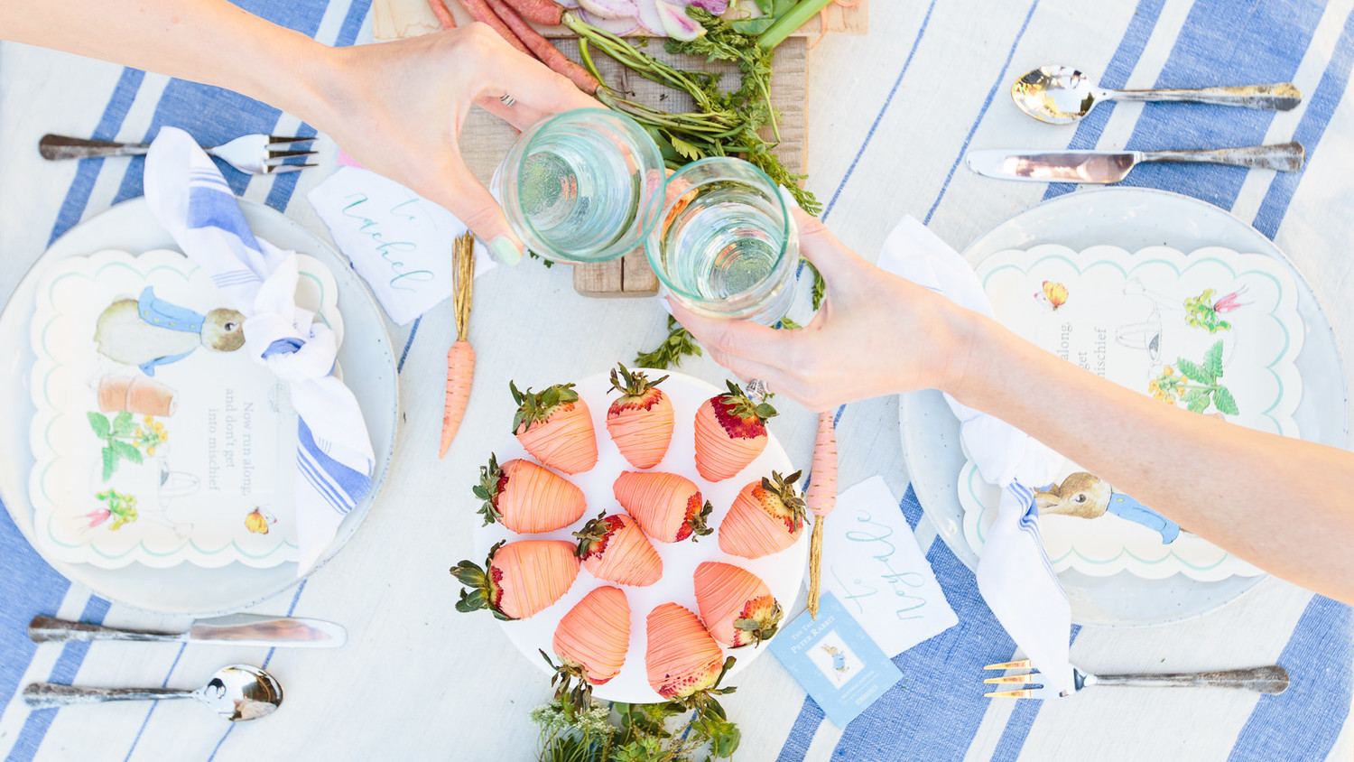 A tablescape with drinks and snacks from a Peter Rabbit-themed baby shower.