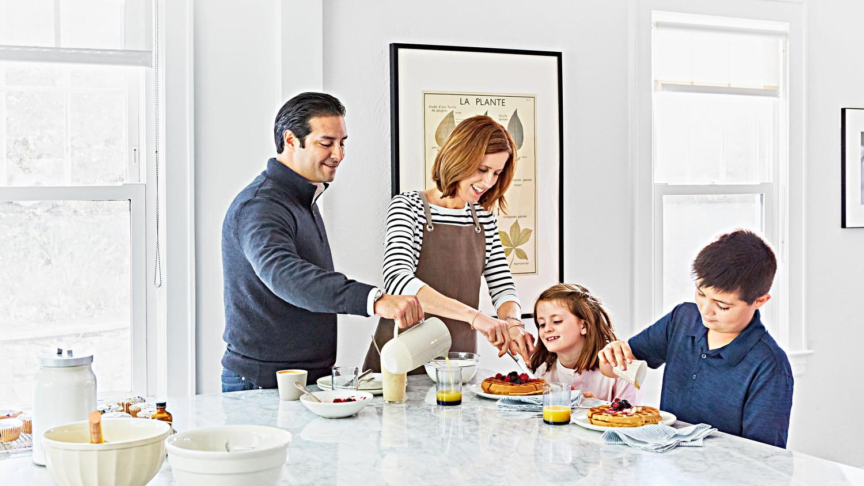 family making eating breakfast