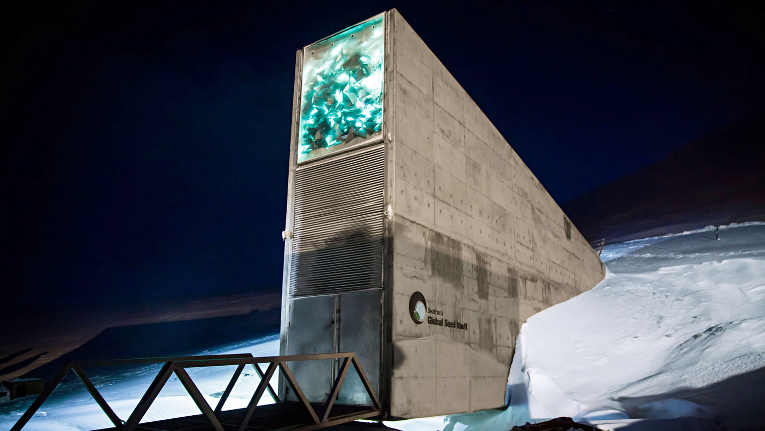 the entrance to the svalbard seed vault protruding from snow