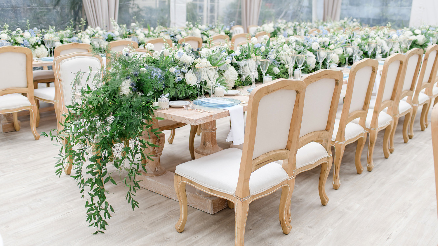 charitable baptism celebration long tables seating chairs greenery centerpiecees