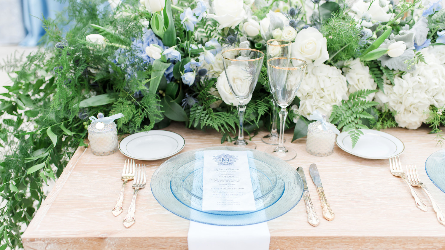 charitable baptism celebration table place setting with flowers