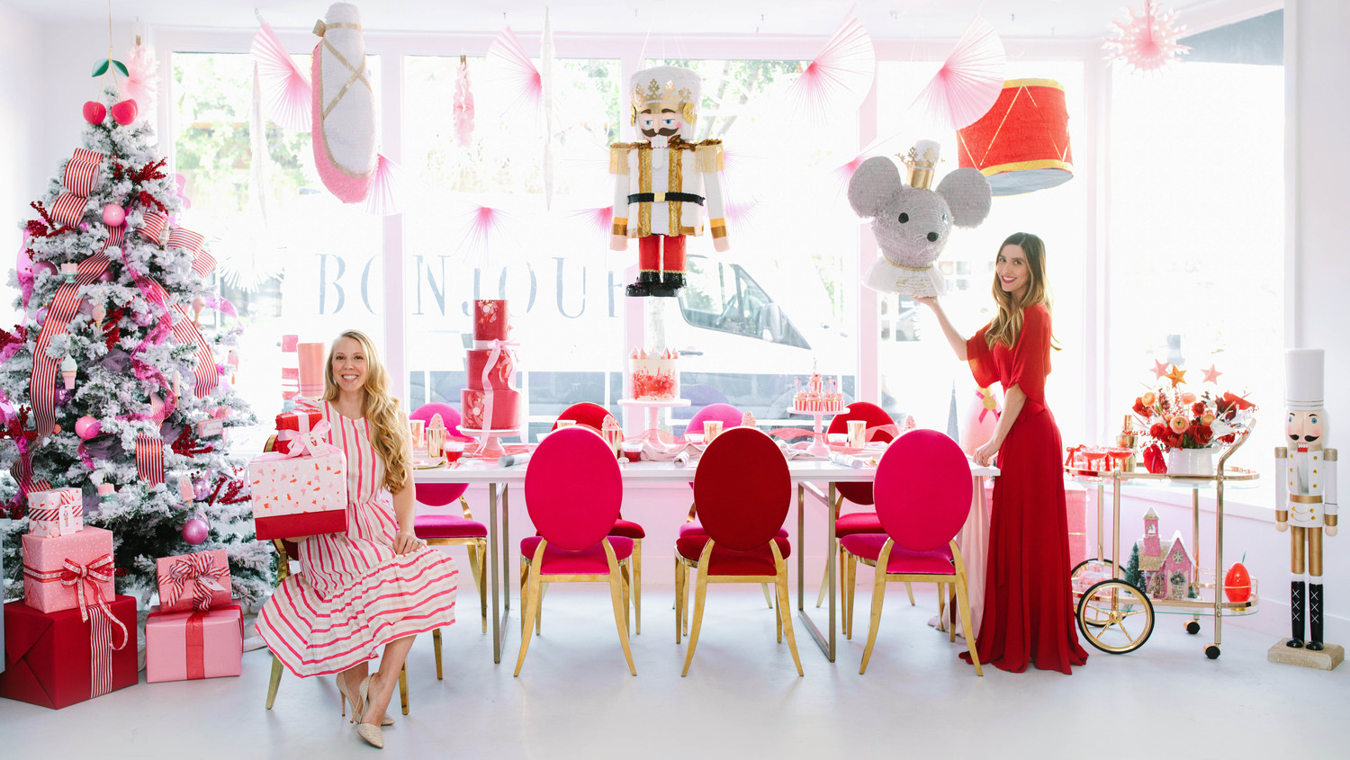 nutcracker christmas party pink red decor with pinatas
