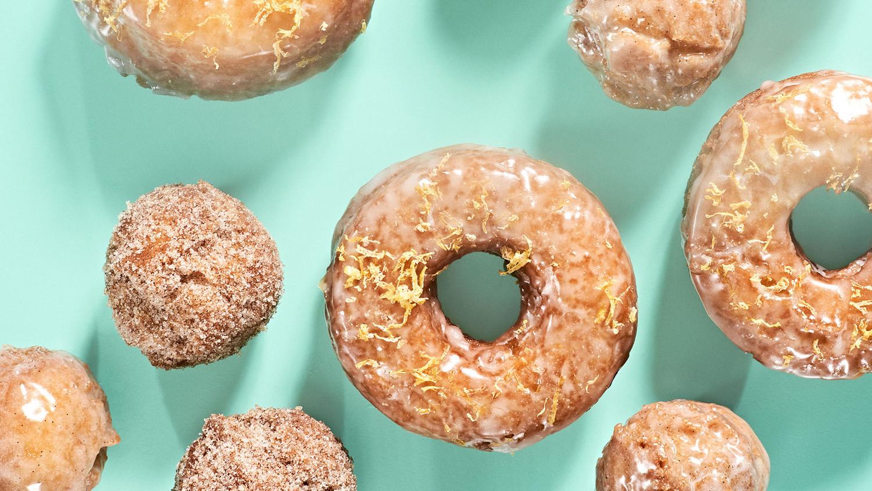 glazed doughnuts and doughnut holes on green countertop