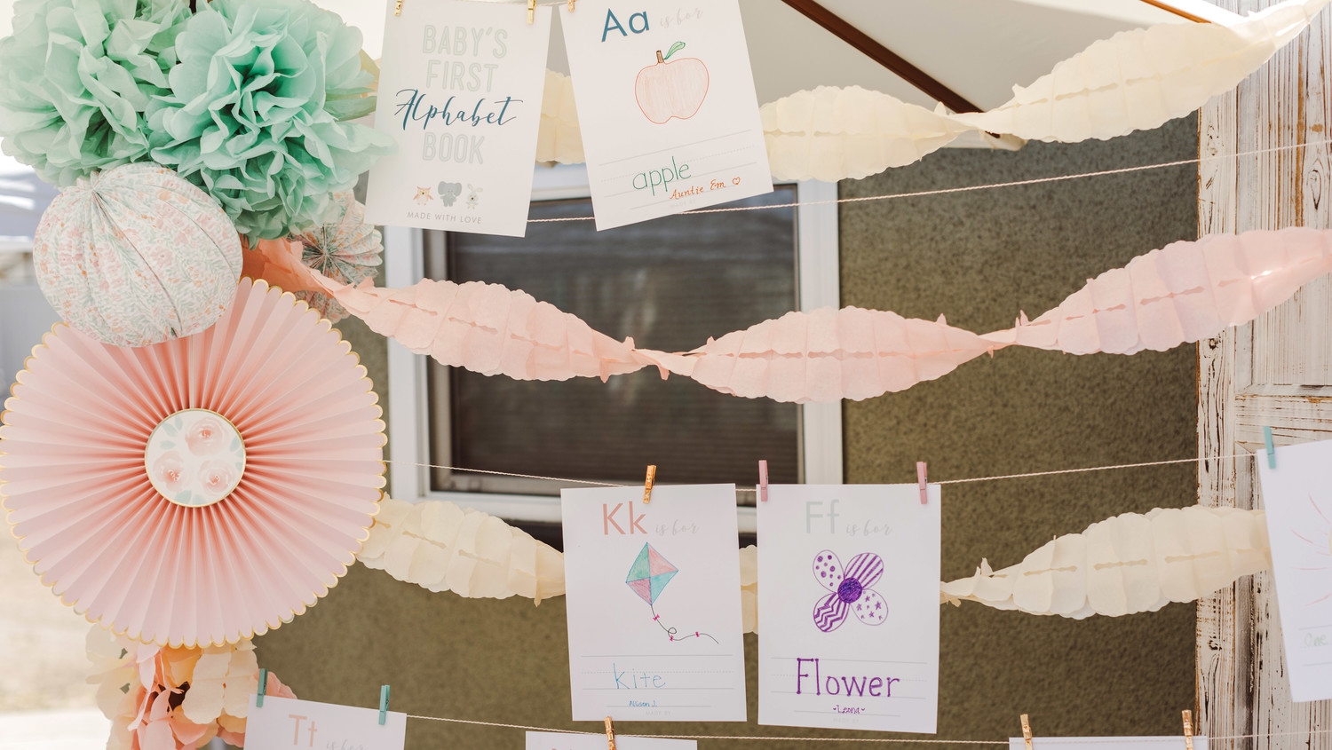 mint blush baby shower baby book pages on decorative clothesline