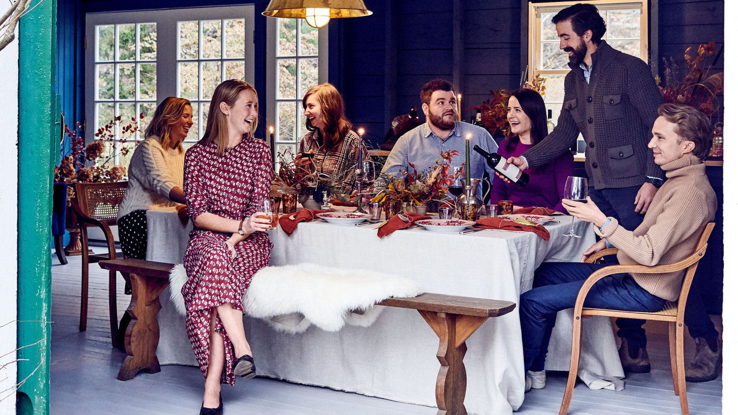 thanksgiving dinner guests at table in barn